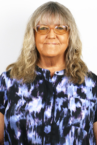 Janie McKinney : Typesetter/Proofreader